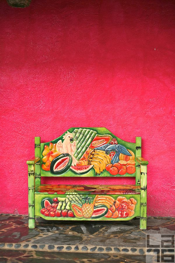 Pink-wall-and-a-colorful-fruit-bench-in-Cabo-San-Lucas-Mexico